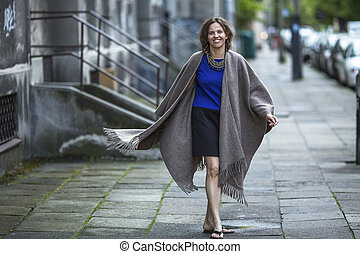 positive woman in a poncho