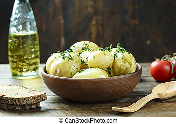 young potatoes boiled with dill on a plate