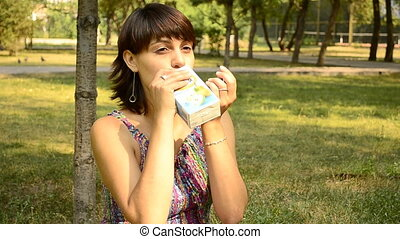 young pregnant woman drinking juice