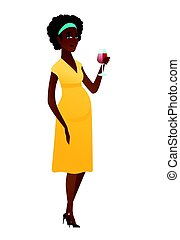 Young pregnant woman holding a glass of wine.