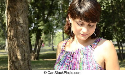 young pregnant woman in a striped