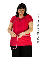 young pregnant woman measuring