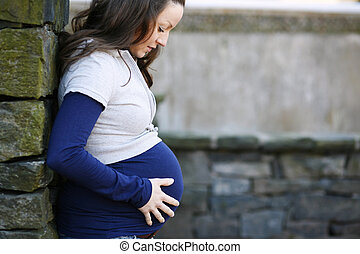 Young pregnant woman outdoors.