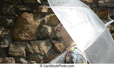 Young pregnant woman under umbrella