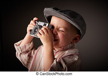 Young press photographer - Young boy with a grey corduroy...