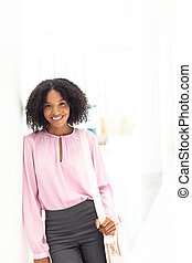 Young pretty African-american employee looking at camera