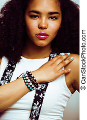 young pretty african american girl emotional posing on white background, lifestyle peopleconcept