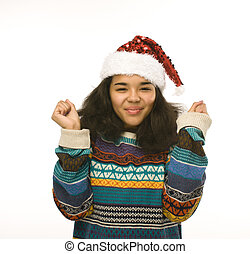 young pretty african american girl in red christmas hat isolated on white background emotional