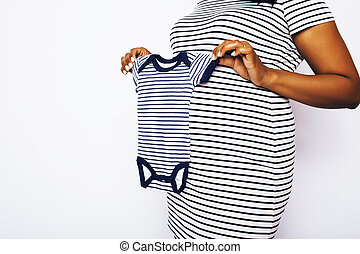 young pretty african american woman pregnant happy smiling, posing on white background isolated , lifestyle people concept copyspace