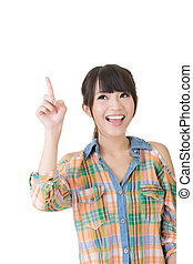Young pretty asian woman pointing up