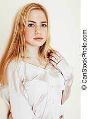 young pretty blond teenage girl close up portrait, lifestyle peo