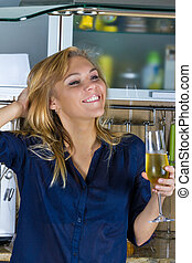 Young pretty blond woman in kitchen