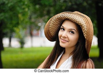young pretty blond woman in park