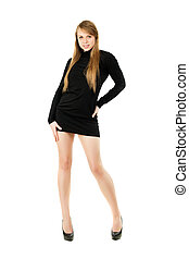 Young pretty blonde posing in black short dress. Isolated on white
