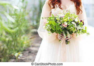 Young pretty bride with bouquet