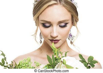 Young pretty caucasian bride with wedding bouquet