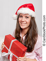 Young pretty brunette and Christmas