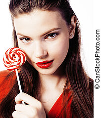young pretty brunette girl with red candy posing on white backgr