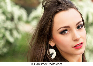 Portrait of young pretty brunette with tousled hair