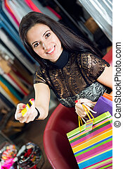 Young pretty brunette shopping