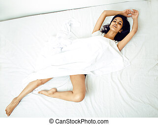 young pretty brunette woman in bed