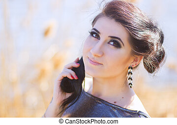 Young pretty brunette woman posing