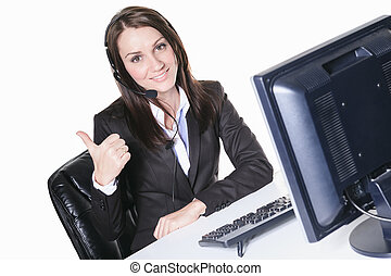Young pretty business woman with computer in the office