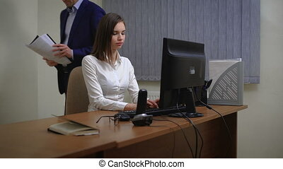 Young pretty business woman with PC in the office