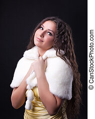 Young pretty girl close-up portrait in fur coat