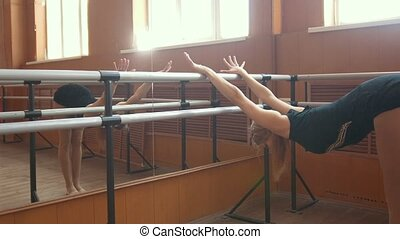 Young pretty girl demonstrates the flexibility of her body,...