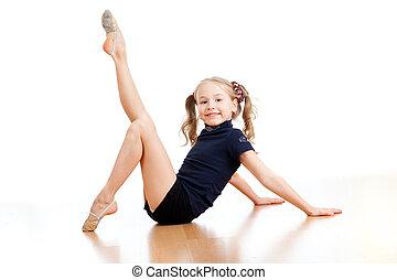 young pretty girl doing gymnastics on floor - pretty girl...