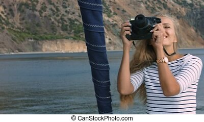 Young pretty girl is taking a picture