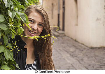 Young pretty girl portrait outdoors.