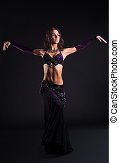 young pretty girl posing in arabic dance