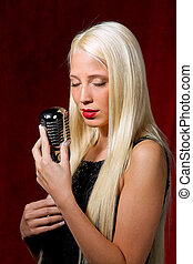 Young pretty girl sings - Young blonde girl with an...