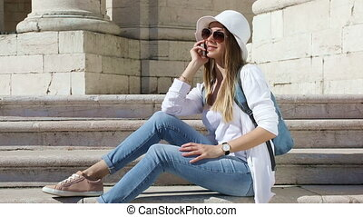 Young pretty girl talking on a cellular phone