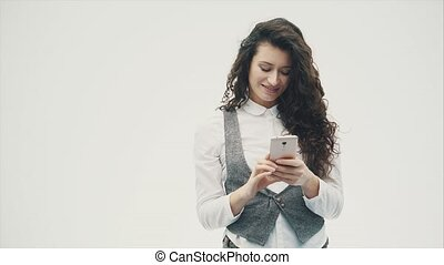 Young pretty girl with curly long hair on a white background.