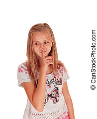 Young pretty girl with finger over mouth.