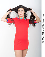 young pretty slim asian woman standing in a little red dress