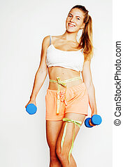 young pretty slim blond woman with dumbbell isolated cheerful smiling, measuring herself, diet people concept