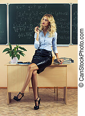 Young pretty teacher resting after checking the tests