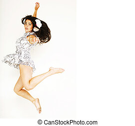 young pretty teenage girl jumping cheerful isolated on white bac