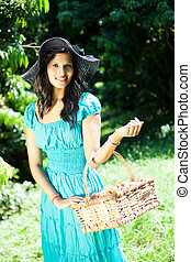 woman carrying a basket of litchis