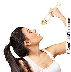 young pretty woman eating sushi over white background