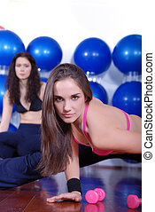 young pretty woman exercising in a fitness center