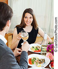 woman having romantic dinner with guy
