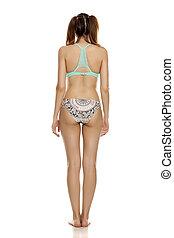 Young pretty woman in bikini