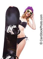 young pretty woman in black bikini hold snowboard