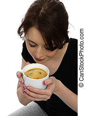 young pretty woman in black shirt scenting coffee in a mug