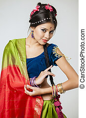 Young pretty woman in indian dress